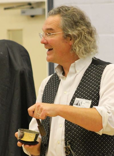 Ian B Dunne Playing a singing bowl at a science show